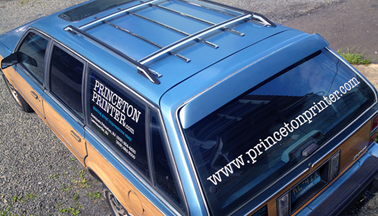 Delivery vehicle with princeton printer logo